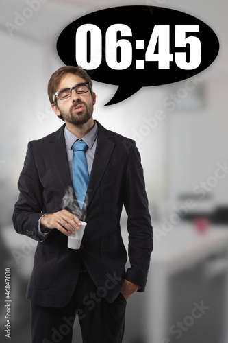 Businessman yawning at morning on the office