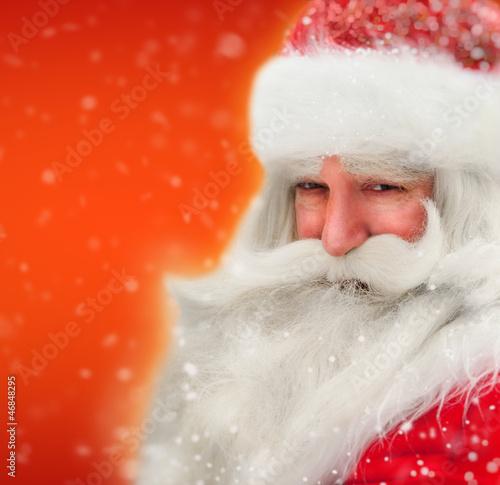 canvas print picture Santa Claus portrait smiling in snowfall