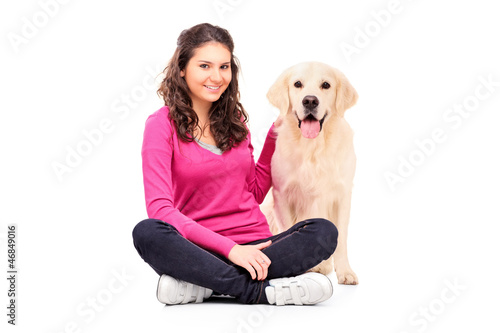 Young female posing with a dog