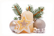 Christmas decorations and advent candle on white background.
