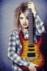 Style girl with guitar.