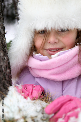 Little girl stood in the snow