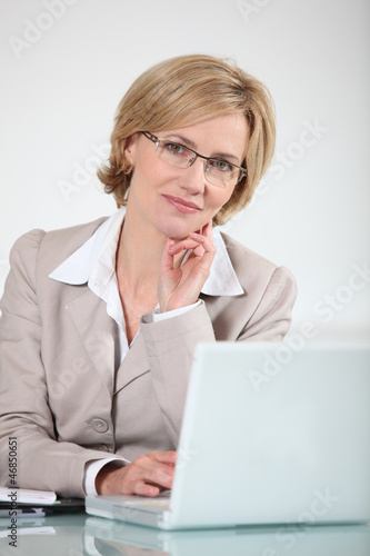 Woman in glasses at laptop computer