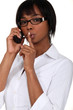 woman on the phone with finger before her mouth