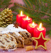 canvas print picture - Four red advent candles and a Christmas stollen.