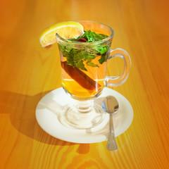 Cinnamon, mint and honey tea on a wooden table