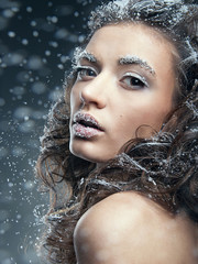 Portrait of young woman with snow make-up. Christmas snow queen