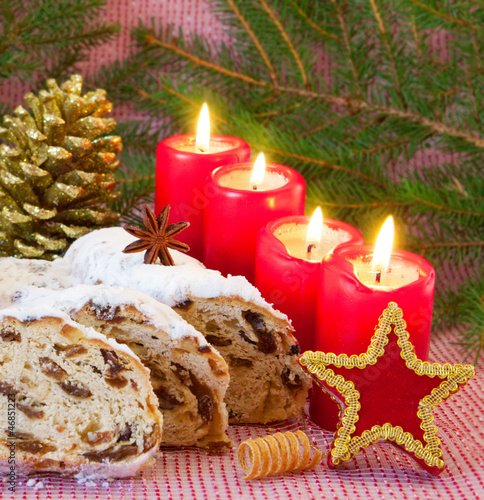 canvas print picture Four red advent candles and a Christmas stollen.