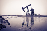 Oil pump jack and reflection, toned color