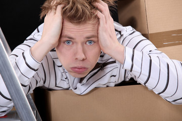 Overwhelmed man on moving day