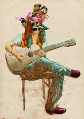 Guitar player - Eccentric with a colored hat.