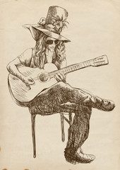 Guitar player - Eccentric with a big hat.