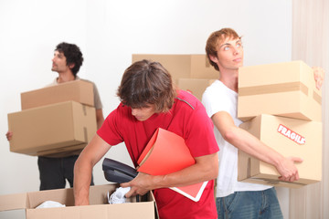 Young men moving house