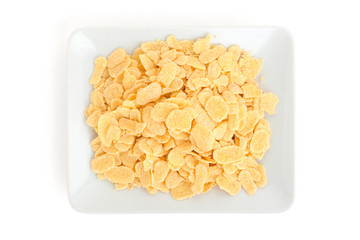 Corn flakes in a plate isolated on white background