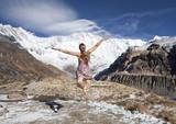 blond girl fly toward snow mountains