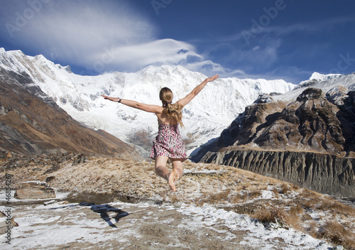 blond girl fly toward snow mountains