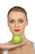 Blond woman posing with green apple