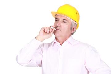 A male architect smoking.