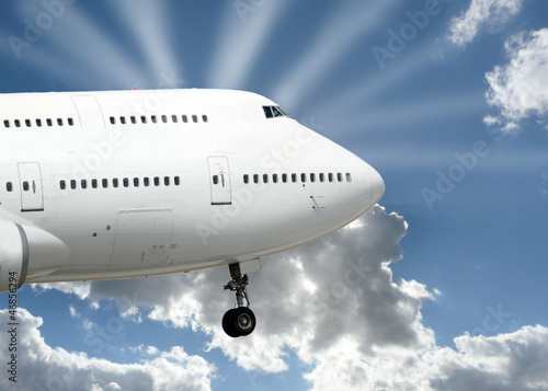 plane with sunbeams