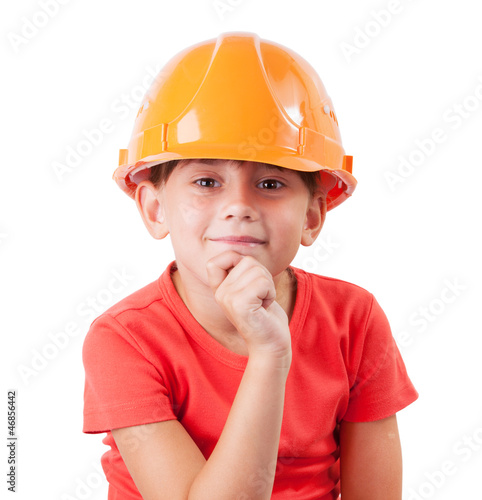 Girl in a protective helmet sits