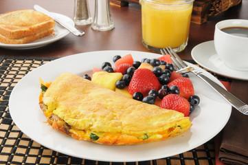 Breakfast omelet wiht fruit and berries