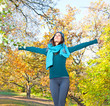Happy young pretty woman at the autumn park.