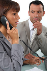 Man observing his colleague on the phone