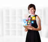 Young woman looking at modern tablet with colourful icons