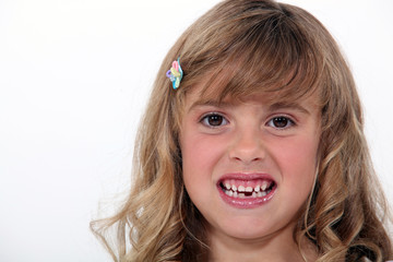 Little girl baring her teeth