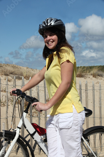 Woman taking a bike ride at the beach