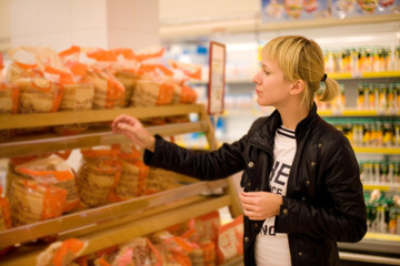 A woman buys bread