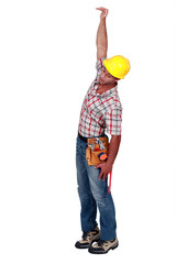 Construction worker hanging in empty space
