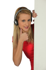 Teenager giving with headphones giving thumbs-up sign