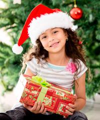 Girl holding a Christmas gift