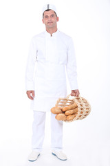 Male bakery worker with basket of bread