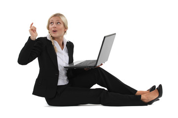 Woman sitting on the floor with computer