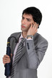 businessman talking on his cell and looking serious