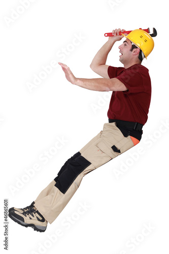 Manual worker falling over