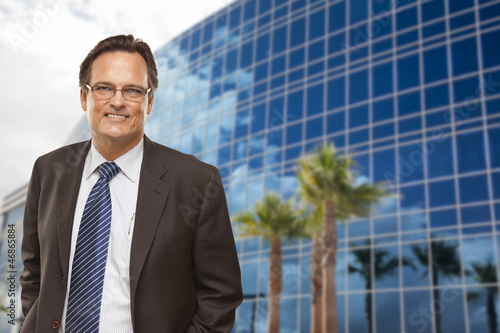 Handsome Businessman Smiling in Front of Building