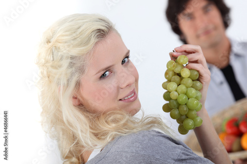 close-up of a young woman with grapes