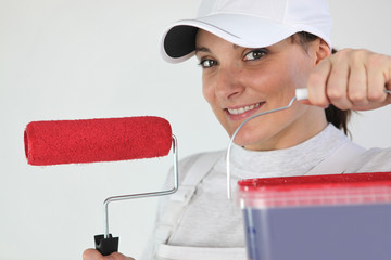 Painter and red paint roller