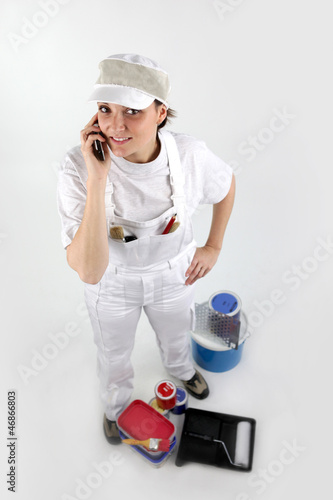 Female painter on the phone