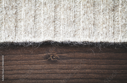 wool sweater on wood