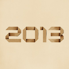 Happy new year 2013 recycled papercraft background.