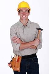 happy craftsman holding a hammer