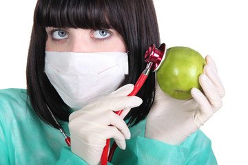 Woman auscultating apple