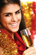 Beautiful young brunette woman drinking champagne at