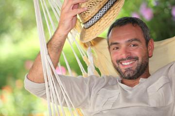 Man with hat on hammock