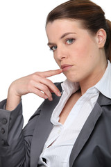 Profile of businesswoman holding hand to face