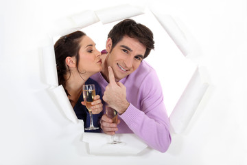 Young couple drinking champagne together